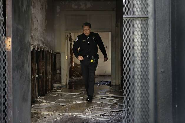 Officer Ivan Sequeira walks through the former Potrero police station on Tuesday, May 22, 2012 in San Francisco, Calif.  A two alarm fire broke out at the former Potrero police station on the corner of Third and 20th Streets on Tuesday afternoon. Photo: Lea Suzuki, The Chronicle