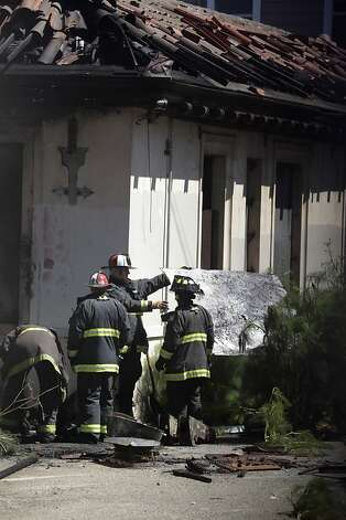 Firefighters work in back of the former Potrero police station, which closed more than 15 years ago, on Tuesday, May 22, 2012 in San Francisco, Calif.  A two alarm fire broke out at the former Potrero police station on the corner of Third and 20th Streets on Tuesday afternoon. Photo: Lea Suzuki, The Chronicle