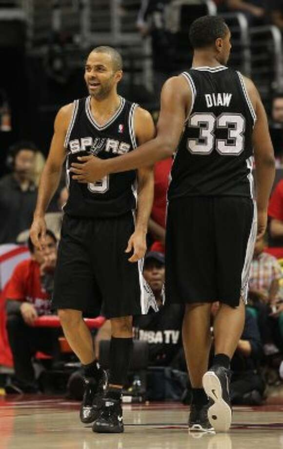 Tony Parker (left) and Boris Diaw are both from France. They are among six international players on the Spurs' roster.  Kin Man Hui/Express-News (SAN ANTONIO EXPRESS-NEWS)