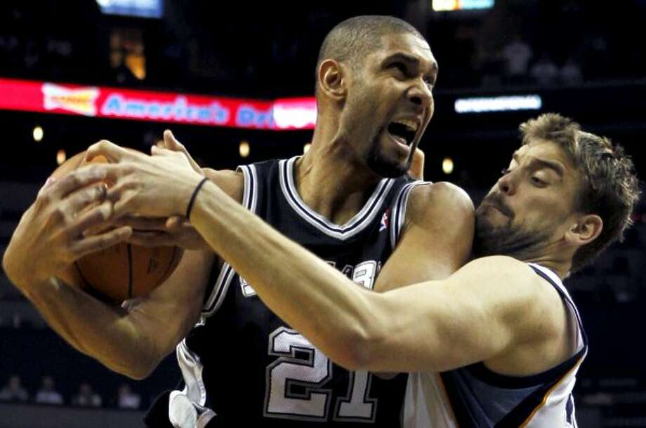 Tim Duncan (left), going head to head with the Grizzlies' Marc Gasol in this season's playoffs, is the oldest player on the Spurs' roster.  Jim Weber/Associated Press (ASSOCIATED PRESS)