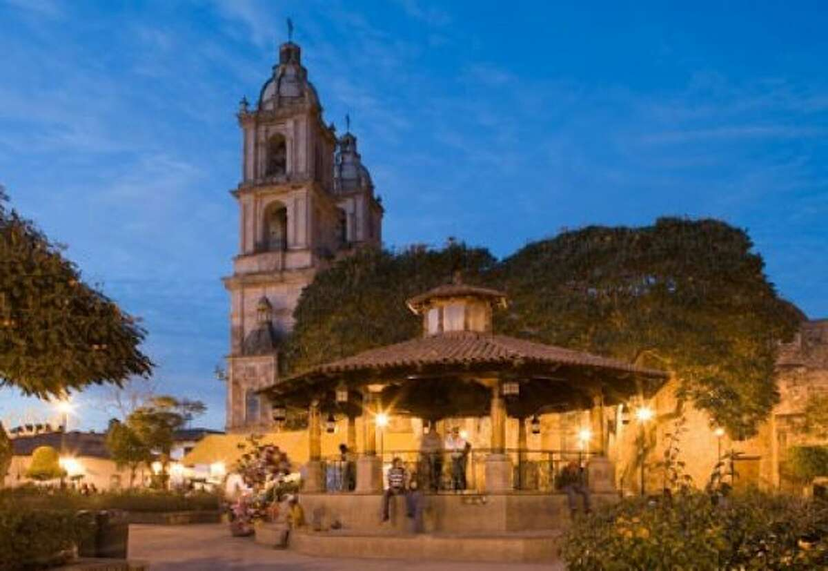 Valle de Bravo proper is a colonial-era Mexican village built around a leafy town plaza where brightly garbed Mazahua Indians sell their handmade tapestries every day.