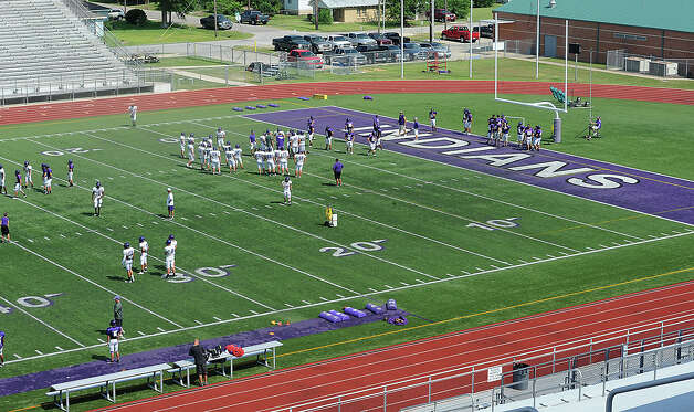 The Port Neches-Groves Indians conduct spring practice at The Reservation on Monday. The field is again a popular topic as the district's board members listened to proposals Monday night to replace the field.  Photo taken Monday, May 21, 2012 Guiseppe Barranco/The Enterprise Photo: Guiseppe Barranco, STAFF PHOTOGRAPHER / The Beaumont Enterprise