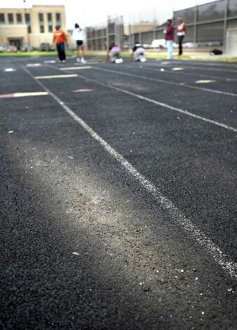 The Central girls track team practices on a worn and damaged track at Central High School in Beaumont, Friday, March 2, 2012. Tammy McKinley/The EnterpriseLITT Photo: TAMMY MCKINLEY