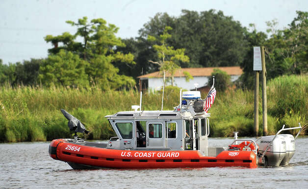 The U.S. Coast Guard searches Cow Bayou off East Roundbunch Road after  J.B. Arrington and friend, Nolan Foreman failed to return from an early morning fishing trip in 2009. Tammy McKinley/The Enterprise Photo: TAMMY MCKINLEY / Beaumont