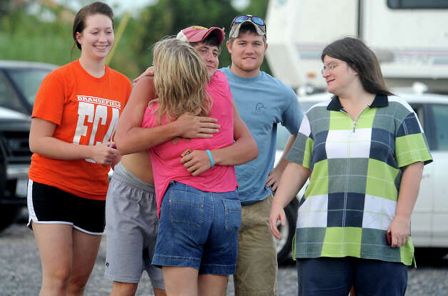 Friends and family of Nolan Foreman gather to celebrate and wait for the rescue of him and J.B. Arrington after they failed to return from an early morning fishing trip in 2009. Tammy McKinley, The Enterprise Photo: TAMMY MCKINLEY / Beaumont