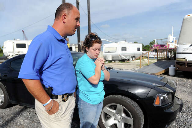 Detective Chad Hogan speaks with relative, Stephanie Goth, about the rescue operation for J.B. Arrington and friend, Nolan Foreman, after the two failed to return from an early morning fishing trip in 2009. Tammy McKinley, The Enterprise Photo: TAMMY MCKINLEY / Beaumont