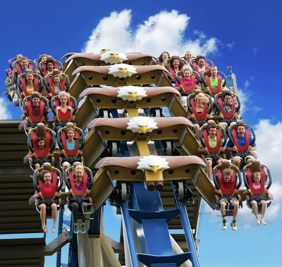 This undated photo provided by Dollywood shows riders on the Wild Eagle, a new 210-foot tall coaster that opened in March at the theme park in Pigeon Forge, Tenn.  The coaster is one of a number of new attractions opening at theme parks around the country this season. Photo: AP