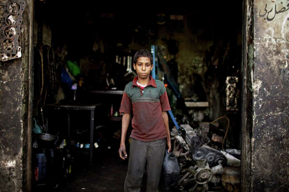 A young Egyptian boy, Mustafa, works on election day in a mechanic shop in Al Saff, Giza Province, Egypt on Wednesday, May 23, 2012. On Wednesday morning, Egypt commenced two days of presidential voting after 16 months of interim rule by the Supreme Council of Armed Forces. This election is the first free and fair race since the ouster of former President Hosni Mubarak.