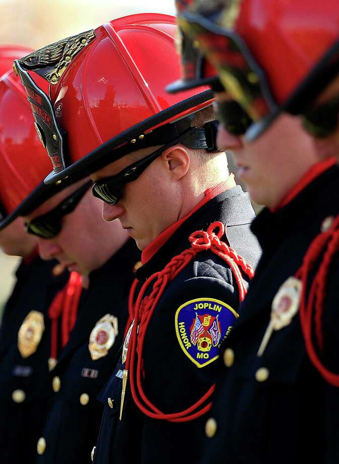 Joplin firefighters bow their heads during a ceremony marking the first anniversary of the EF-5 tornado that killed 161 people, Tuesday, May 22, 2012, in Joplin, Mo. The tornado that cut a wide swath through Joplin is the costliest on record. Photo: Charlie Riedel, AP / AP