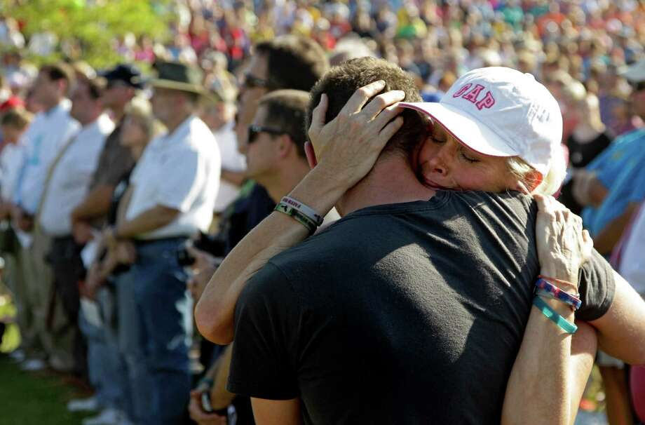 Marilyn Sixx hugs her son, Chris Sixx, during a ceremony marking the anniversary of a deadly tornado that devastated Joplin, Mo., a year ago on Tuesday, May 22, 2012. The twister killed 161 people as it cut a wide swath through Joplin. Photo: Charlie Riedel, AP / AP