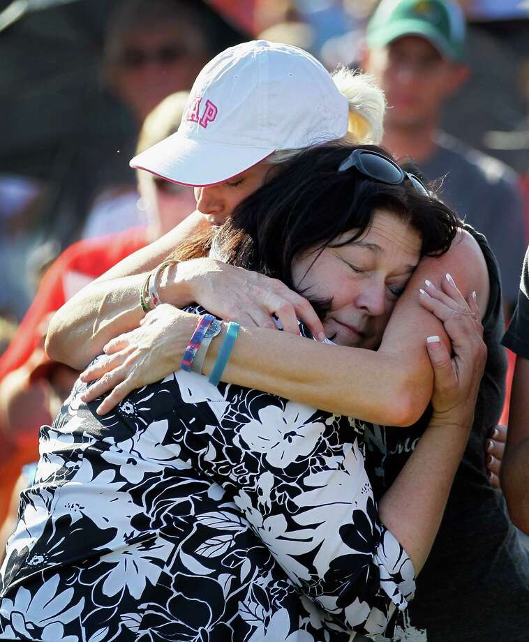 JOPLIN, MO - MAY 22: Carole Liston hugs Marilyn Sixx in Cunningham Park during ceremony that included a moment of silence at 5:41 p.m. which was when the monstrous tornado first hit the city a year ago to the day on May 22, 2012 in Joplin, Missouri. The EF-5 tornado devastated the area leaving  behind a path of destruction along with 161 deaths and hundreds of injuries, but one year later there are signs that the town is beginning to recover. Photo: Joe Raedle, Getty Images / 2012 Getty Images