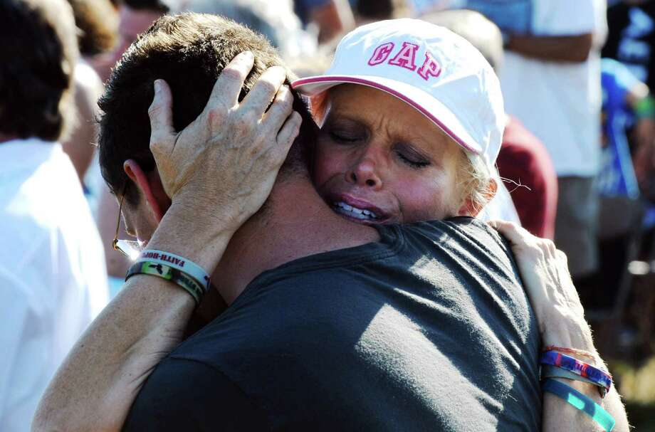 Marilyn Sixx embraces her son, Chris Sixx, during a ceremony marking the anniversary of a deadly tornado that devastated Joplin, Mo., a year ago on Tuesday, May 22, 2012, at Cunningham Park in Joplin. The twister killed 161 people as it cut a wide swath through the city. Photo: T. Rob Brown, AP / The Joplin Globe