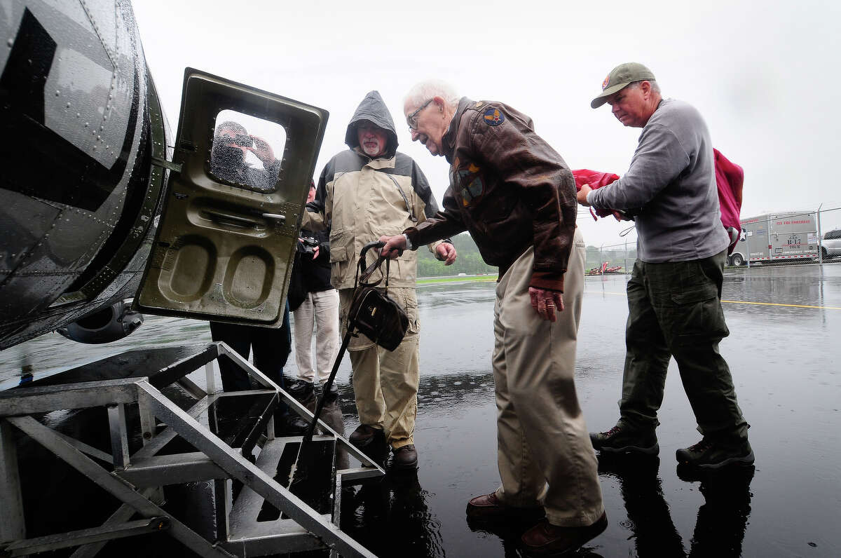 Retired B-17 pilot Emerson Tolle, 90, is helped into