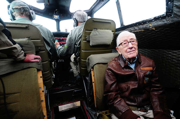 "Decorated B-17 pilot Emerson Tolle, 90, rides in a jump seat aboard ""Aluminum Overcast"" during a flight from the Museum of Flight in Seattle on Monday, May 21, 2012. The WWII-era B-17 ""Flying Fortress"" bomber is one of only a dozen remaining airworthy aircraft. From May 24th thru the 27th, EAA and the Museum of Flight will offer ground tours and ""mission"" flights for a fee. Photo: LINDSEY WASSON / SEATTLEPI.COM"