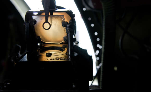 "Light pours through the elevated bore sight of a side turret during a flight of ""Aluminum Overcast"" on Monday, May 21, 2012. The WWII-era B-17 ""Flying Fortress"" bomber is one of only a dozen remaining airworthy aircraft. From May 24th thru the 27th, EAA and the Museum of Flight will offer ground tours and ""mission"" flights for a fee. Photo: LINDSEY WASSON / SEATTLEPI.COM"