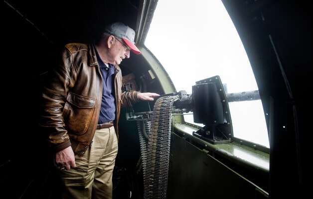 "Air Force veteran Ted Gary takes a look out the starboard gunner's window during a flight of ""Aluminum Overcast"" on Monday, May 21, 2012. The WWII-era B-17 ""Flying Fortress"" bomber is one of only a dozen remaining airworthy aircraft. From May 24th thru the 27th, EAA and the Museum of Flight will offer ground tours and ""mission"" flights for a fee. Photo: LINDSEY WASSON / SEATTLEPI.COM"