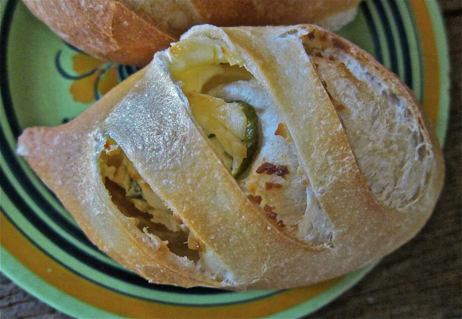 A jalapeño-cream cheese mini bolillo from El Bolillo Bakery make a great breakfast treat. Photo: Alison Cook