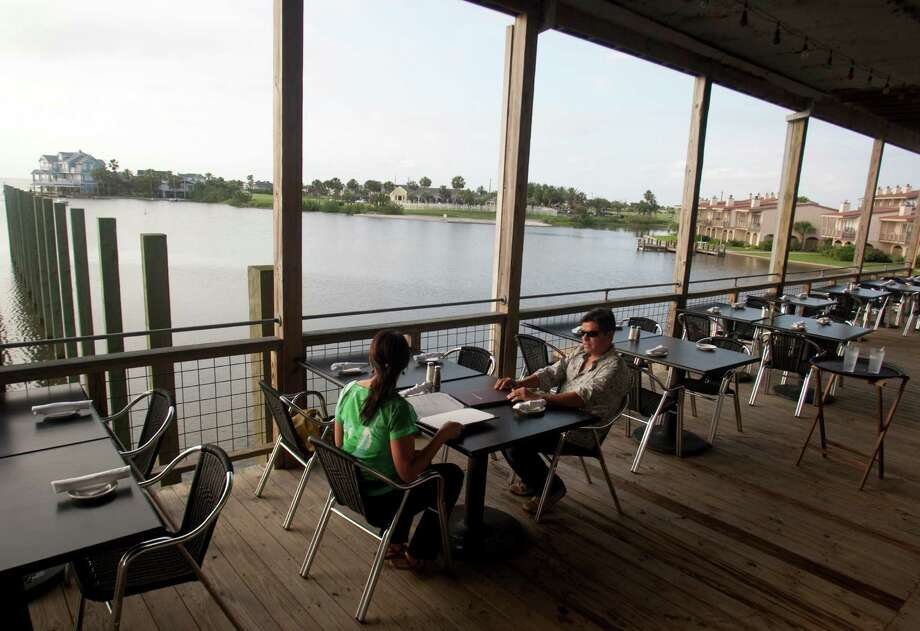 The Waterman restaurant also has a back porch overlooking Lake Como for guest to enjoy.  ( J. Patric Schneider / For the Chronicle ) Photo: J. Patric Schneider / Houston Chronicle