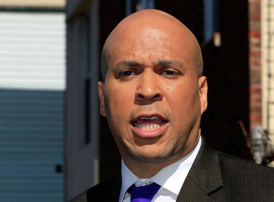 """FILE - In this April 13, 2012 file photo, Newark, N.J. Mayor Cory Booker speaks in Newark. Booker, an Obama ally, is the latest politician in damage-control mode in a presidential race already noteworthy for the informal spokespeople who veer wildly off message. His criticism of """"nauseating"""" ads like the Obama campaign attack on Mitt Romney's business record illustrates the difficulty of controlling the message. Photo: AP"""