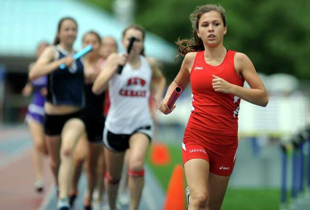 Greenwich's Kathryn Bernstein competes in the 4x800 meter relay during the FCIAC boys and girls track championships held Tuesday, May 22, 2012 at Danbury High School. Photo: Autumn Driscoll / Connecticut Post