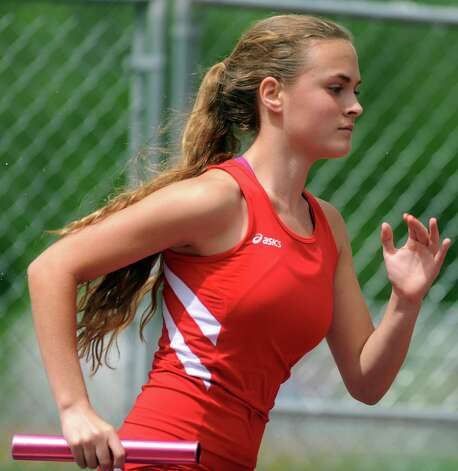 Greenwich's Mia Bonanno competes in the 4x800 meter relay during the FCIAC boys and girls track championships held Tuesday, May 22, 2012 at Danbury High School. Photo: Autumn Driscoll / Connecticut Post