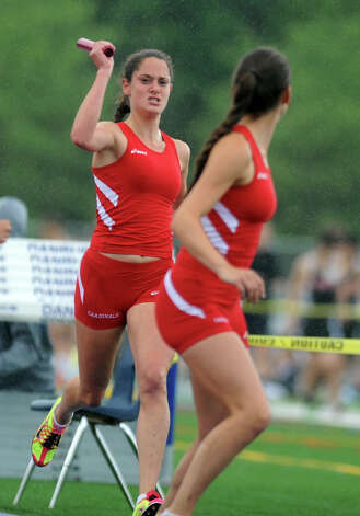 Greenwich's Abigail Markowitz hands off to Elizabeth Markowitz in the 4x800 meter relay during the FCIAC boys and girls track championships held Tuesday, May 22, 2012 at Danbury High School. Photo: Autumn Driscoll / Connecticut Post
