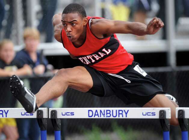 Central's Andre Aiken 110 meter high hurdles during the FCIAC boys and girls track championships held Tuesday, May 22, 2012 at Danbury High School. Photo: Autumn Driscoll / Connecticut Post
