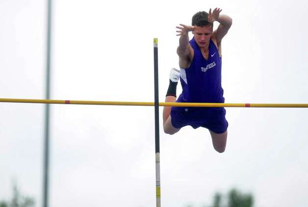 Westhill's Evan McCafferty clears 12 feet during the pole vault event at the FCIAC boys and girls track championships held Tuesday, May 22, 2012 at Danbury High School. Photo: Autumn Driscoll / Connecticut Post