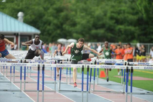 The FCIAC boys and girls track championships held Tuesday, May 22, 2012 at Danbury High School. Photo: Autumn Driscoll / Connecticut Post