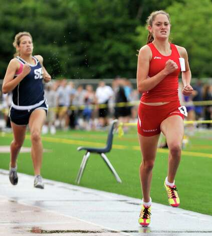 Greenwich's Abby Markowitz, right, finishes first in the girls 800-meter-run, finishing ahead of Staples' Alexandra Popkin, left, during the FCIAC track and field championships at Danbury High School on Tuesday, May 22, 2012. Photo: Jason Rearick / The News-Times