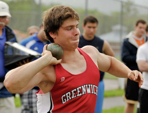 Greenwich's Robert Gelcius competes in the shot put during the FCIAC track and field championships at Danbury High School on Tuesday, May 22, 2012. Gelcius received second place in the shot put. Photo: Jason Rearick / The News-Times