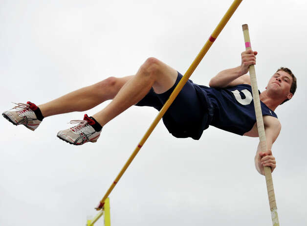 Staples' Aiden McConnell competes in the pole vault during the FCIAC track and field championships at Danbury High School on Tuesday, May 22, 2012. McConnell finished in a three-way-tie for fifth place. Photo: Jason Rearick / The News-Times