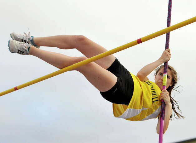 Trumbull's Maranda Cotto competes in the pole vault during the FCIAC track and field championships at Danbury High School on Tuesday, May 22, 2012. Photo: Jason Rearick / The News-Times