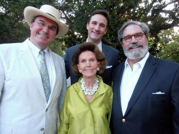 Honoree Patsy Steves is surrounded by son Sam Bell Steves, from left, grandson Tres Steves and son Edward Steves at the San Antonio  Botanical Garden's annual gala, Splendor in the Garden. Photo: Nancy Cook-Monroe, For The Express-News