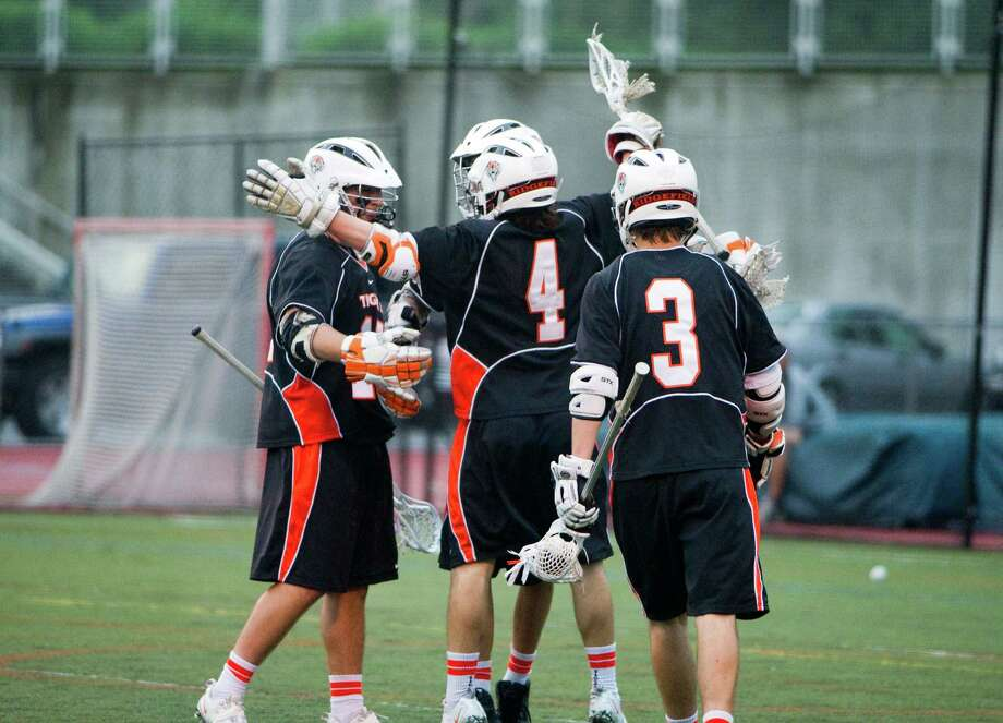 Ridgefield celebrates a goal as Darien and Ridgefield face off in the FCIAC boys lacrosse semifinals at Brien McMahon High School in Norwalk, Conn., May 22, 2012. Photo: Keelin Daly / Stamford Advocate