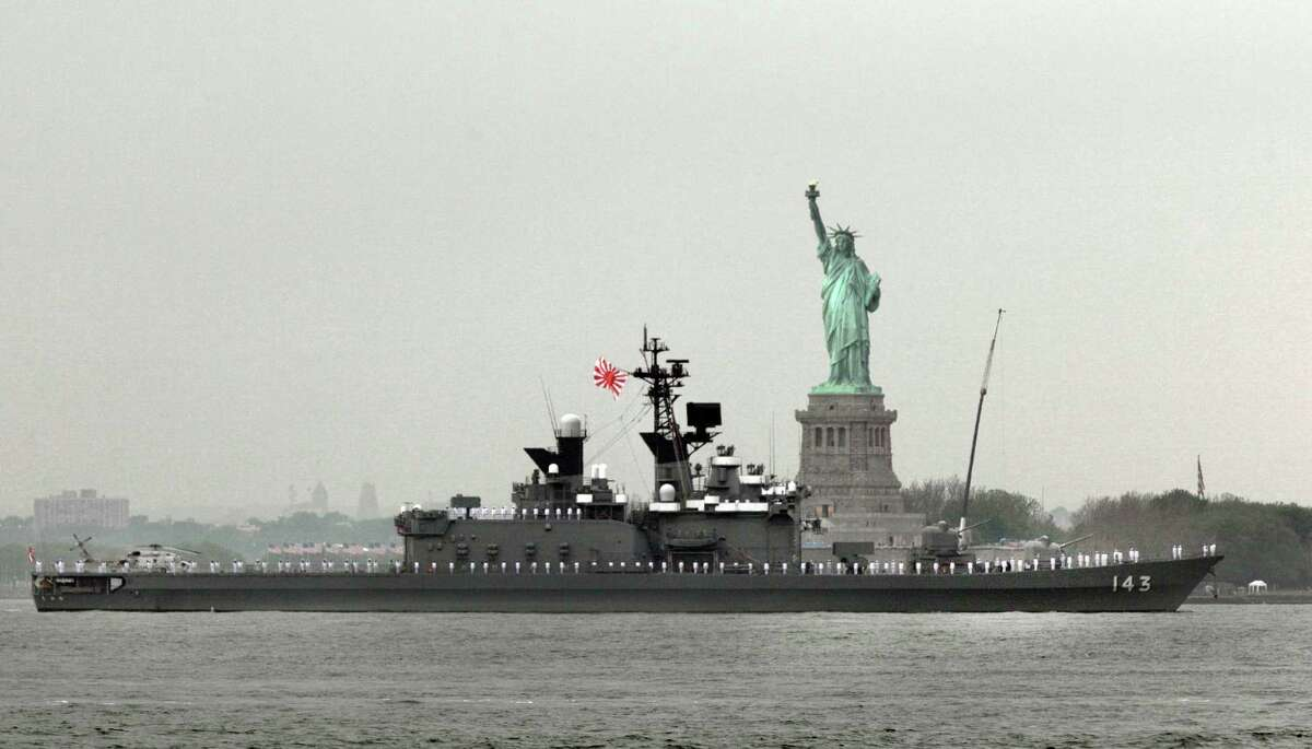 The JS Shirane, from Japan, sails by the Statue Of Liberty, in New York, to participate in Fleet Week activities, Wednesday. (AP Photo/Richard Drew)