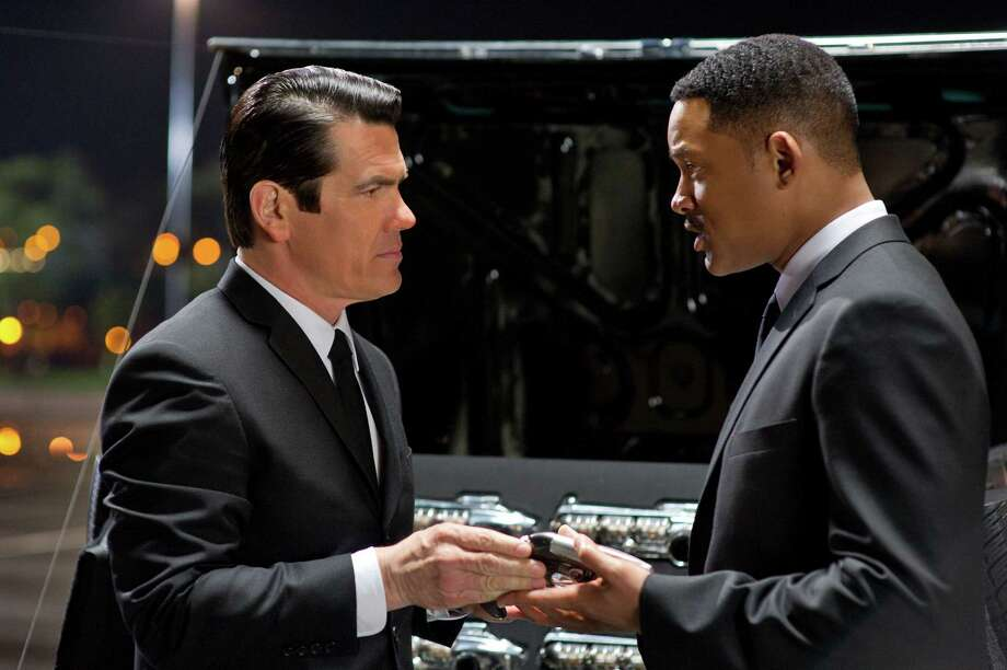 "In this film image released by Sony Pictures, Josh Brolin, left, and Will Smith star are shown in a scene from ""Men in Black 3."" (AP Photo/Columbia Pictures-Sony, Wilson Webb) Photo: AP, HONS / © 2011 Columbia Pictures Industries, Inc.  All rights reserved."