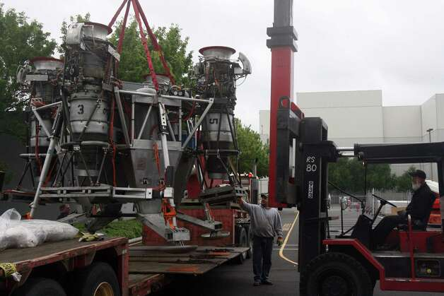 A crane lifts Charon, a vehicle that commercial spaceflight company Blue Origin used to test vertical takeoff and landing,  off of a flat-bed truck outside of the Seattle Museum of Flight's Space Gallery on Tuesday, May 23, 2012. Photo: Aubrey Cohen/seattlepi.com