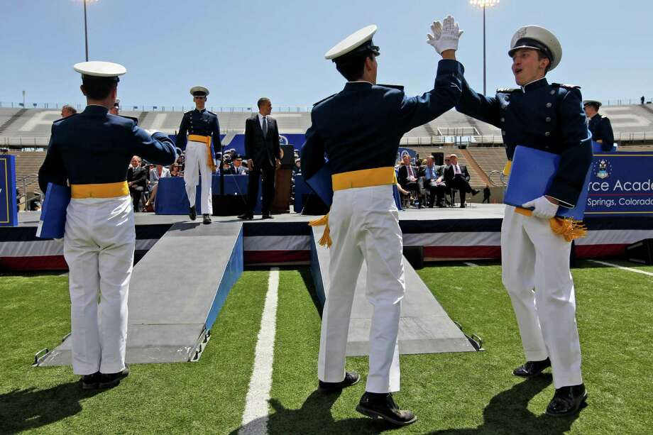 Cadets celebrate after being congratulated by President Barack Obama, center, during the graduation ceremonies at the U.S. Air Force Academy, Wednesday, May 23, 2012, in Colorado Springs, Colo. (AP Photo/Pablo Martinez Monsivais) Photo: Pablo Martinez Monsivais, Associated Press / AP