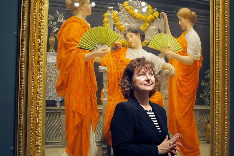 "Curator Lynn Orr poses for a picture in front of Albert Moore's ""Midsummer"", oil on canvas painting of 1887 on display for the ""The Cult of Beauty"" exhibition at the Legion of Honor in San Francisco, Calif. on May 21, 2012. Photo: Siana Hristova, The Chronicle"