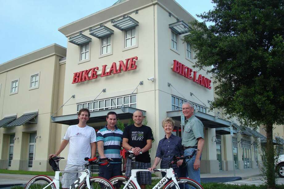 The professioanls at Bike Lane, from left, Micah McGee, Ken Thurlow, Jon Whaley, Jane Beimgraben and Herb Beimgraben enjoy The Woodands weather in front of the Bike Lane store.