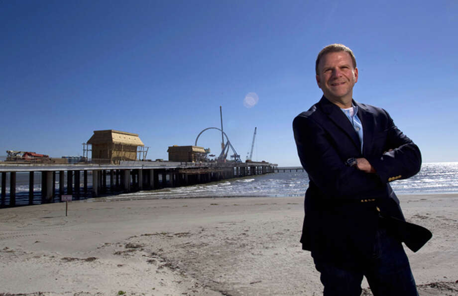 Portrait of entrepreneur, developer and restauranteur Tilman Fertitta next to his latest venture Pleasure Pier along Seawall and 25th St. at the former location of the Flagship Hotel Saturday, Jan. 28, 2012, in Galveston. Photo: Johnny Hanson, Houston Chronicle / © 2012  Houston Chronicle
