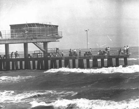 Rough surf does not deter fishing from Galveston's Pleasure Pier, 1962. (Houston Chronicle)