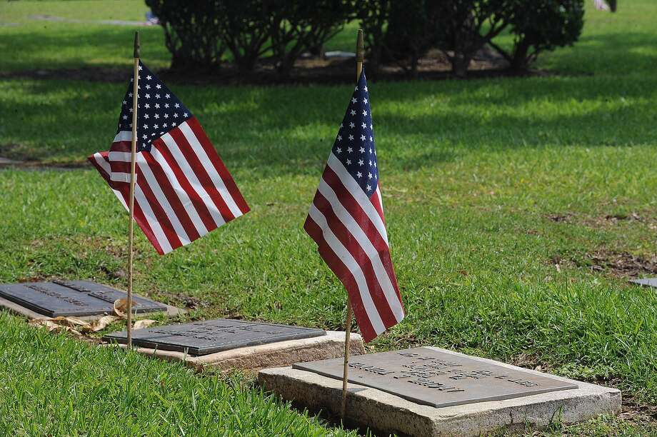 Flags are placed at veterans' graves at Forest Lawn Memorial Park Cemetery. A Memorial Day service is planned from 10 a.m. to noon Monday. The event will include speakers, musical entertainment and lunch. Guiseppe Barranco/The Enterprise Photo: Guiseppe Barranco / Beaumont
