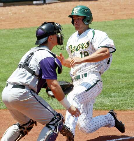 Baylor's Cal Towey (right) tries to slide past Kansas State catcher Blair DeBord during the Big 12 tournament. The Bears rolled 11-1. Photo: AP