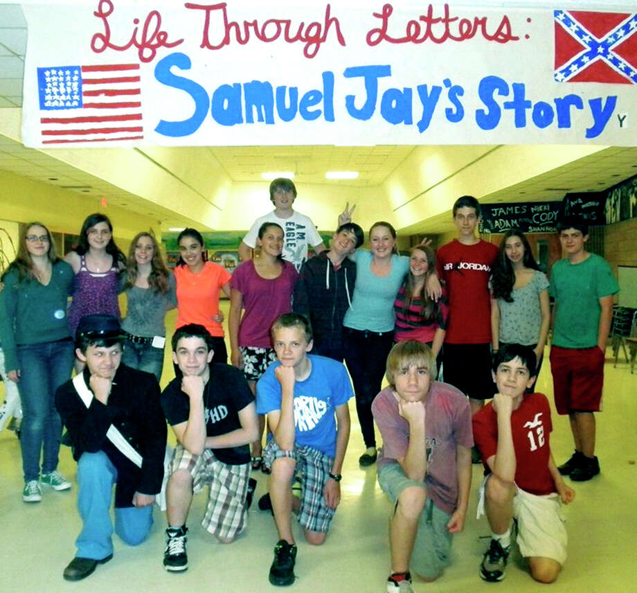 Eighth-grade students at Shepaug Valley Middle School proudly promote the book they have published ìLife Through Letters: Samuel Jayís Story,î to commemorate Washington Civil War soldier Samuel Jay Nettleton of the 8th Connecticut Regiment. Here the students gather for a keepsake photo in the school mall. May 2012  Courtesy of Shepaug Valley Middle School Photo: Contributed Photo
