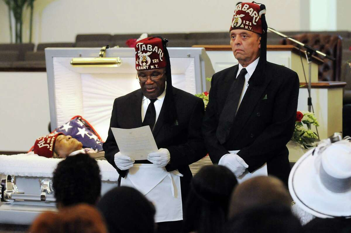 Richard L. Smalls, center, and George E. DeWitt of Al Tabari Temple No. 121 take part in a special service for Nebraska Brace before his funeral service on Wednesday, May 23, 2012, at Metropolitan New Testament Missionary Baptist Church in Albany, N.Y. (Cindy Schultz / Times Union)