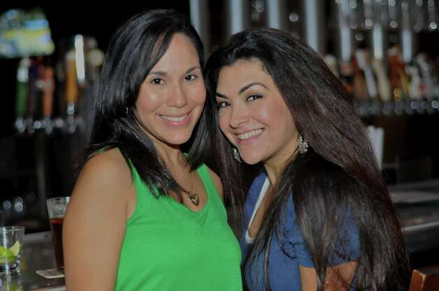 PUB_CRAWL_YARD_HOUSE_ MAY_ 2012. Annette Manlapaz and Karyn Camarillo at Yard House. Photo By Xelina Flores-Chasnoff Photo: Xelina Flores-Chasnoff