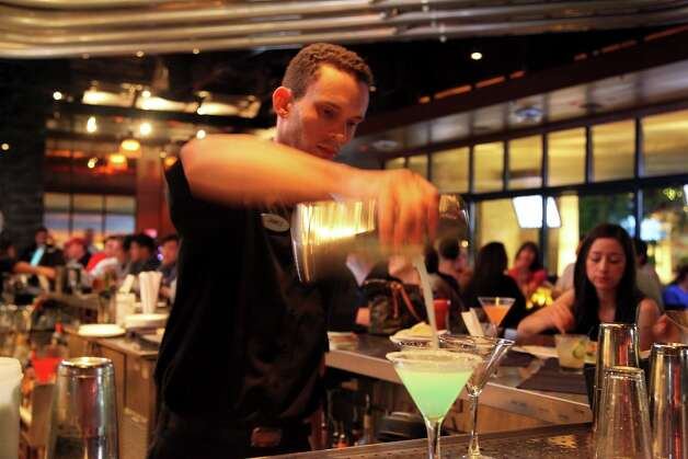 PUB_CRAWL_YARD_HOUSE_ MAY_ 2012. James Gregory making drinks at Yard House. Photo By Xelina Flores-Chasnoff Photo: Xelina Flores-Chasnoff