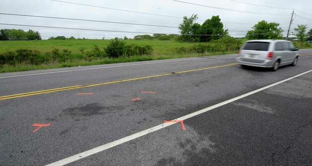 The scene of a fatal accident in Halfmoon, N.Y. looking west on Route 146 is under investigation by law enforcement May 23, 2012.   (Skip Dickstein / Times Union) Photo: SKIP DICKSTEIN